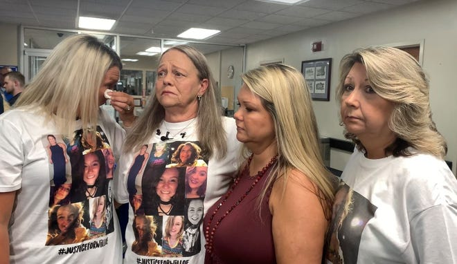 Jennifer Cox, left, cries while Kathy Harrison, second from left, speaks with reporters about the death of her granddaughter, Willoe Watkins, following a preliminary hearing for the accused in 2019 alongside Willoe's cousin, Lori Hudgins, and aunt, Bethany Watkins. On Wednesday, Kendal Tyler Battles of McCalla was convicted of murder in connection with Watkins' death. [Staff photo/Stephanie Taylor]