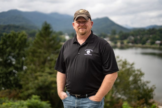 Andy Ledford, founder of the anti-human trafficking group Operation Wolf Eyes, pictured with Lake Junaluska to his back on Sept. 16.