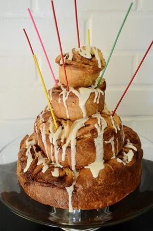 For a dramatic presentation, bake the rolls in different size cake pans, stack and just add birthday candles
