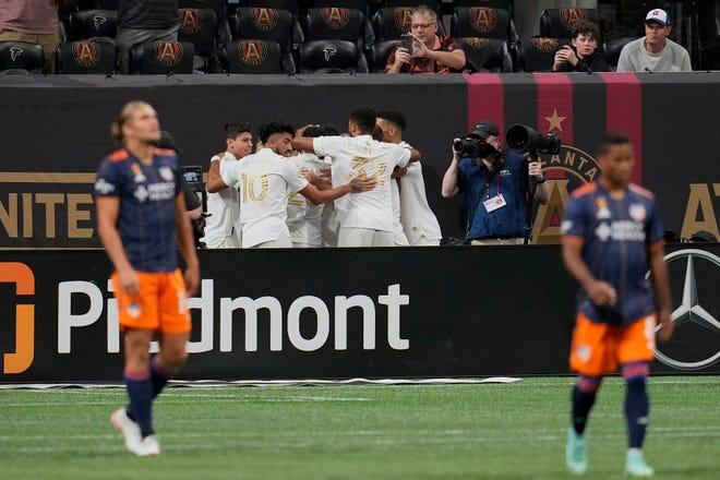 Sep 15, 2021; Atlanta, Georgia, USA; Members of  Atlanta United celebrate after a goal against FC Cincinnati during the first half at Mercedes-Benz Stadium.