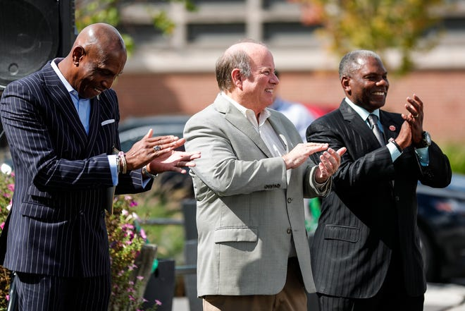 President and CEO Detroit Economic Growth Corporation Kevin Johnson, left, Mayor Mike Duggan and City Council member Roy McCalister Jr. claps at they listen to speakers at the announcement of the opening round of Motor City Match on Livernois Avenue in Detroit on Thursday, Sept. 16, 2021.