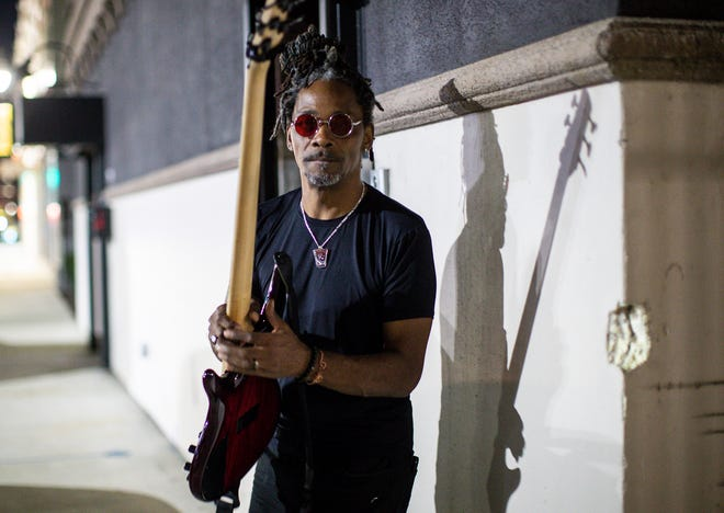 """Detroit bass player Grover Tigue says he's the """"squeaky wheel in his circle of people"""" who enourages good recordkeeping for gig workers. Tigue before performing at Craft Cannabis Club in Detroit on Sept. 15, 2021."""
