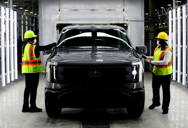(L to R) Kelly Jones and Rhonda Cenance, pre-delivery inspectors look over a 2022 Ford F-150 Lightning inside the plant where it will be built, the Rouge Electric Vehicle Center at the Ford Rouge Plant in Dearborn on Thursday, September 16, 2021.