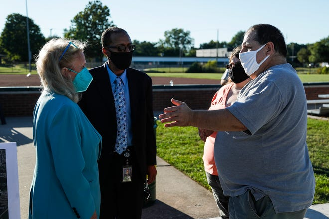 Flat Rock resident Chris and Elizabeth Snodgrass talk to Rep. Debbie Dingell at the Flat Rock Community Fields in Flat Rock on Thursday, Sept. 16, 2021.