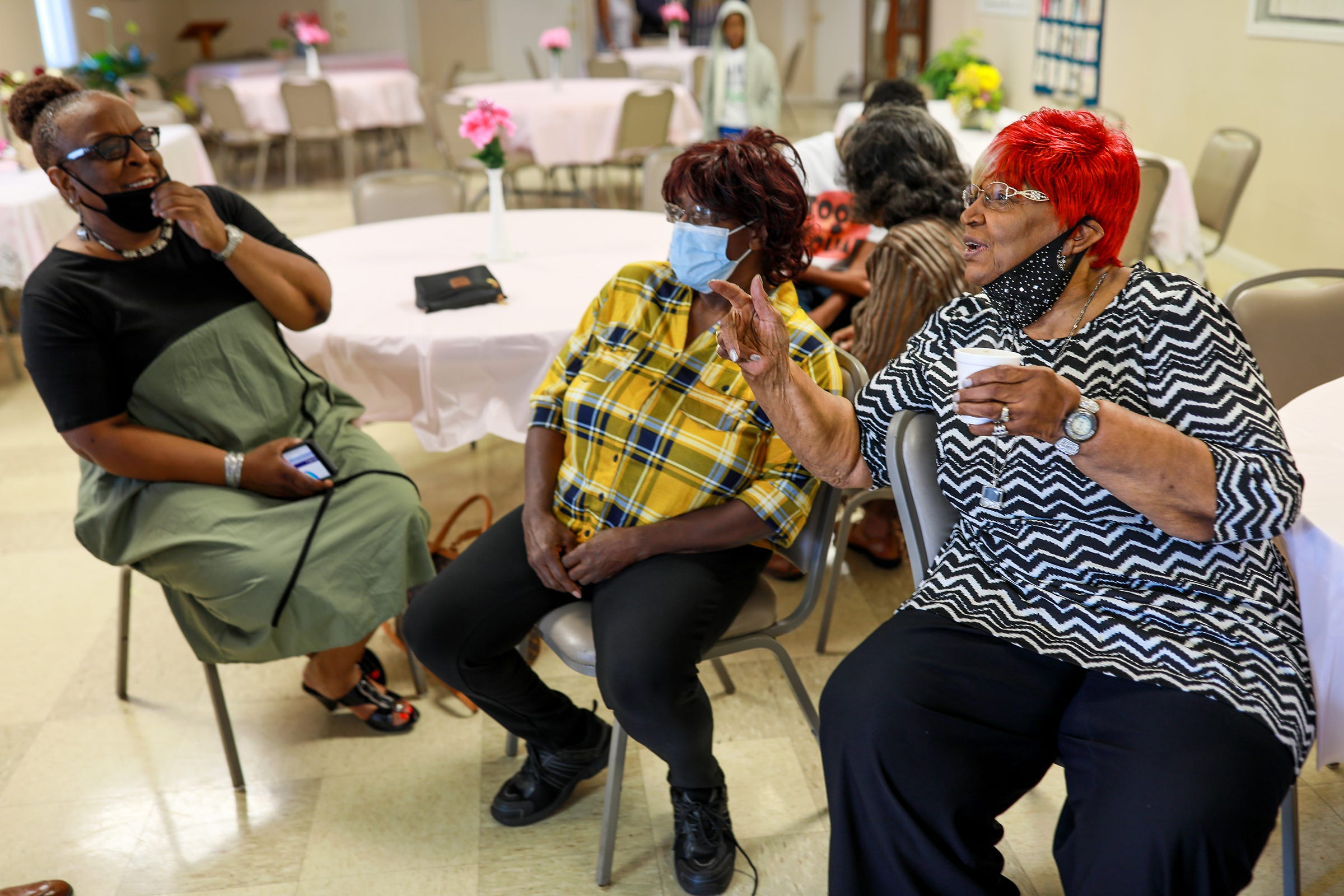 Bessie Stallworth, 90, of Detroit, right, talks with Deloris Miller, 70, of Southfield and her daughter Gwendolyn Stallworth, 60, of Southfield, left, during the Veterans breakfast held at the Northend Church of God and Christ on Saturday, Sept. 11, 2021. Bessie Stallworth has been a member of the church since she moved to Detroit in 1950, during the second wave of the Great Migration from the south, and has been committed to the church as much as she has been to Detroit and the family she raised in Detroit.