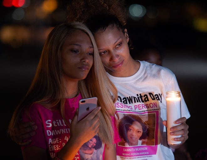 Kaylen Whitledge, 16, left, and Lauran Eastwood, both of Evansville, attend the lantern lighting during Find Dawnita Day at the Four Freedoms Monument in Evansville, Ind., Wednesday evening, Sept. 15, 2021. The event was held for Evansville resident Dawnita Wilkerson, who was last seen June 21, 2020.