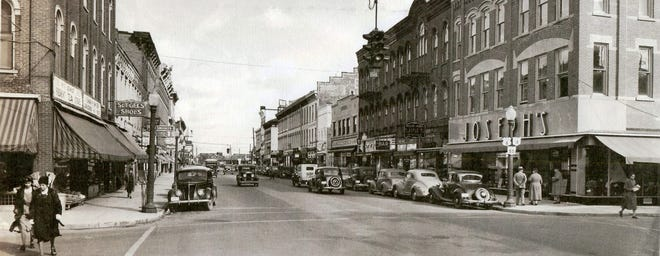 This wide-angle photograph, looking north on Front Street from Garrison Street in Fremont, is so detailed it makes you feel like an actual downtown pedestrian in the 1940s. Notice the tightly-parked cars in front of all the businesses, as well as the once-familiar globe light poles. Most of the buildings from Garrison to Croghan are still standing today. (Submitted by Larry Michaels andKrista Michaels)