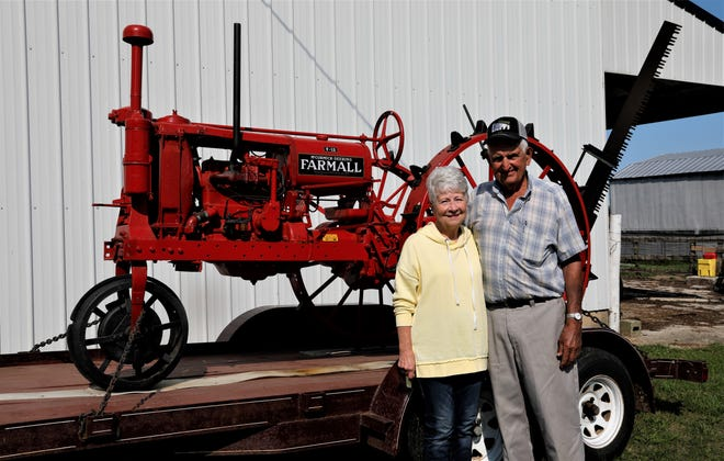 Jim and Marilyn Miller, of J-Mar Farm in Amanda, pose with one of Jim's restored antique tractors. J-Mar Farm has been operating for 100 years, and is being recognized as a Century Farm by the Ohio Department of Agriculture.