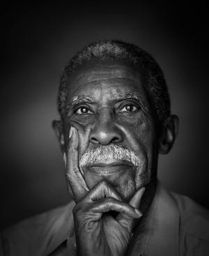 Dr. Harold Franklin, photographed in 2014 for an Auburn University alumni publication, became the university's first Black student when he registered for classes in 1964 under a federal court integration order.