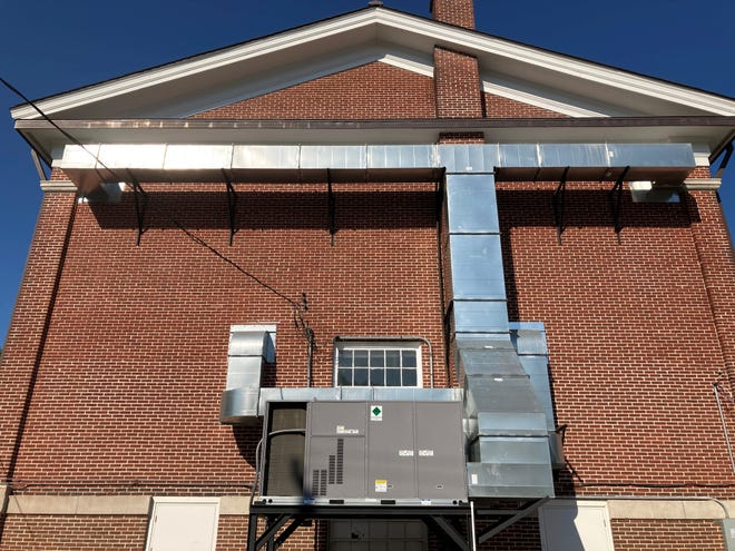 New duct work to provide air conditioning to the theater atop the Old Town Hall will be painted to more closely match the existing brick.