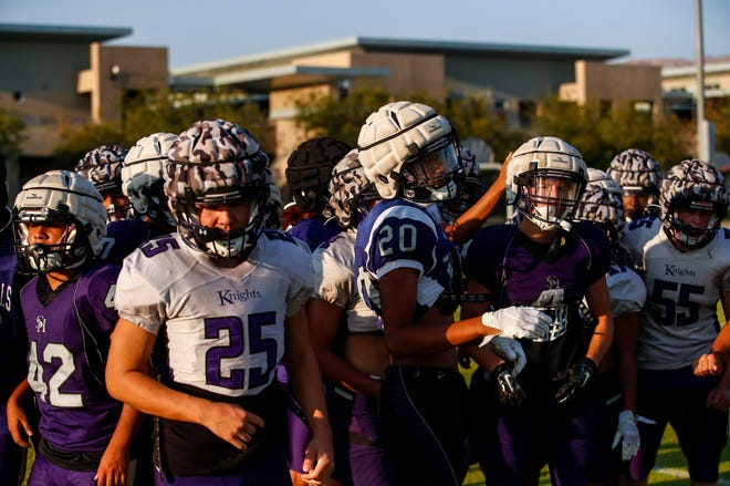 Shadow Hills players head off the field after a team break to get a drink of water during practice at Shadow Hills High School, Tuesday, Sept. 14, 2021, in Indio.