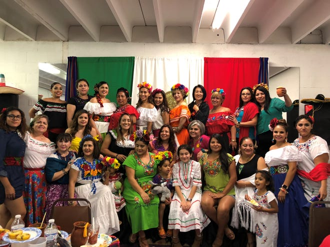 Lucía Ortíz poses with her Zumba dance group during a Fiestas Patrias celebration.