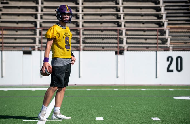 Adam Shaffer, junior quarterback for the Salinas High School varsity football team looks at his coach during an afternoon practice inside the home stadium of the Cowboys in Salinas, Calif., on Monday, Sept. 13, 2021.