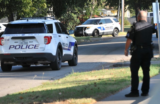 A heavy police presence closed part of a residential street on Eighth Street Thursday morning. A barricaded man was later shot and killed by Wichita Falls Police.