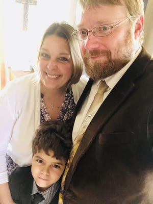 Julie and Ryan Averitt are seen with their son, Austin (not in foster care). The family is named the Foster Parents of the Year by the Texas Council of Child Welfare Boards.