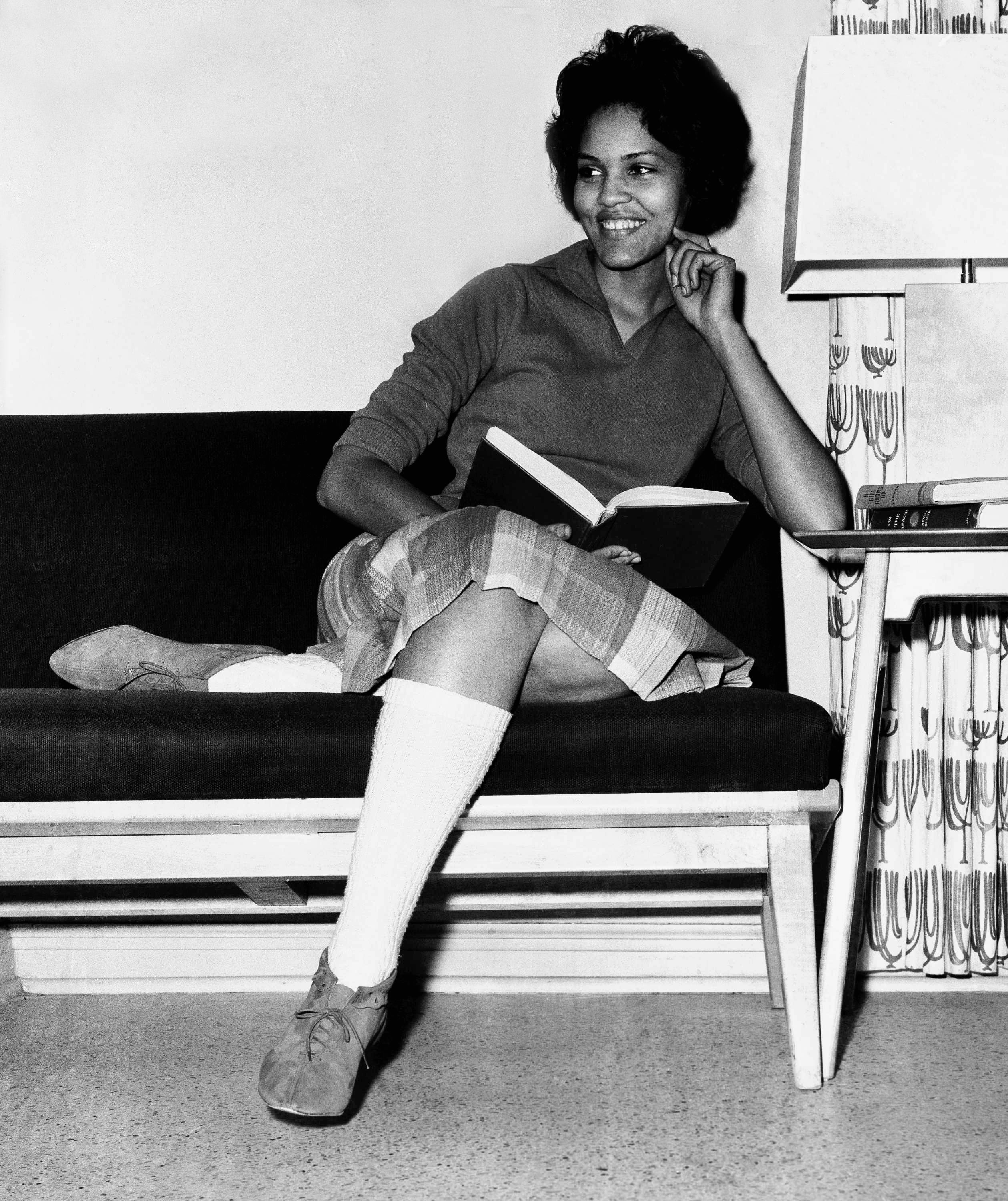 Student Charlayne Hunter, 18, the first Black woman to enter the University of Georgia, relaxes momentarily from her studies in her dormitory in Athens, Georgia, on Jan. 11, 1961.
