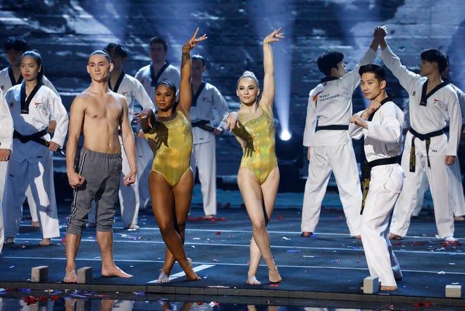 "(l-r) Aidan Bryant, Jordan Chiles, MyKayla Skinner and World Taekwondo Demonstration Team perform on the season finale of ""America's Got Talent."""