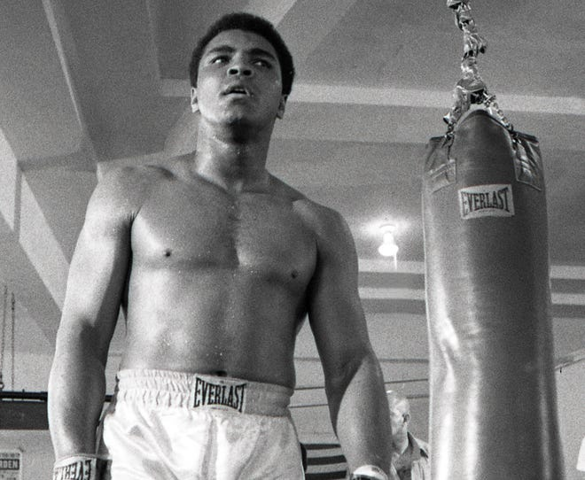 Muhammad Ali, shown Feb 24, 1971, trains on the heavy bag at the 5th Street Gym in Miami Beach for his world heavyweight title bout with Joe Frazier.