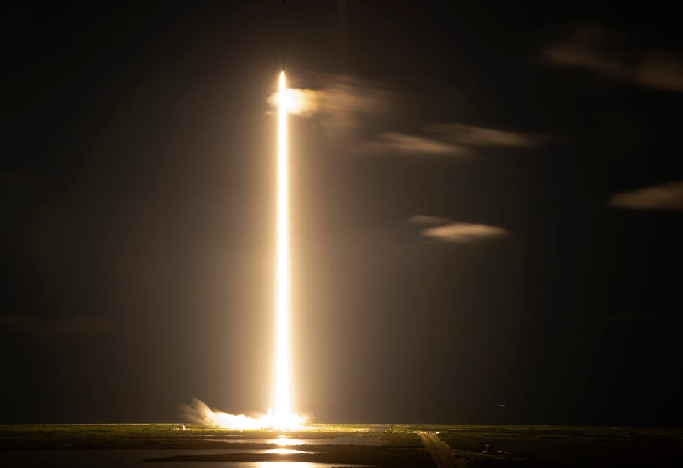 A long exposure shows the SpaceX Falcon 9 rocket with Crew Dragon capsule as it flies into orbit.