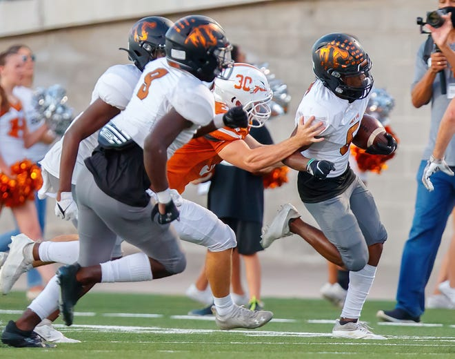 Hutto wide receiver Gary Choice tries to escape Westwood defenders during the Hippos' 44-21 win Thursday at Kelly Reeves Stadium.