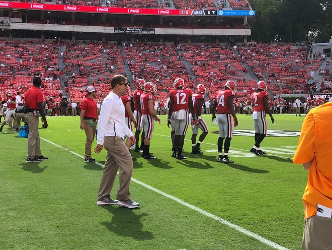 Mental conditioning coach Trevor Moawad on Sanford Stadium field before Georgia game against Tennessee on Sept. 29, 2018, (Marc Weiszer/Staff).