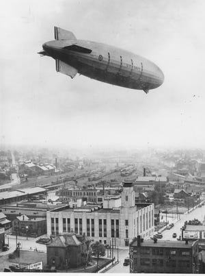 The USS Akron passes over the Akron Times-Press, later the home of the Beacon Journal, during the maiden flight Sept. 23, 1931.