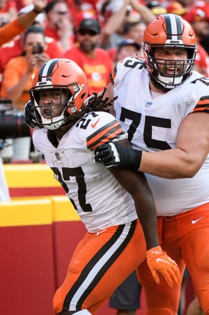 Cleveland Browns running back Kareem Hunt (27) and guard Joel Bitonio (75) celebrate after Hunt scored a touchdown against the Kansas City Chiefs during the second half on Sept.12 in Kansas City, Mo. Bitonio will play his 100th game with the Browns when they play the Los Angeles Chargers on Sunday. [Reed Hoffmann/Associated Press]