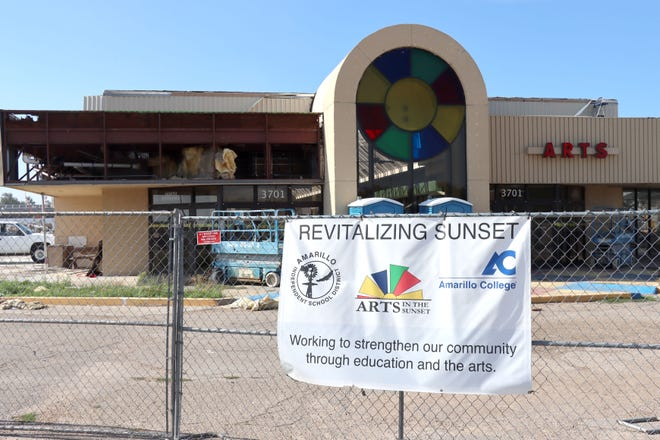 """The Arts in the Sunset Center west entrance is seen during the demolition phase, with a sign titled """"Revitalizing Sunset"""" on one of the construction gates."""