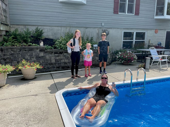 The Detterman family of New London were the grand prize winners of Firelands Electric Cooperative's back-to-school photo contest. In the photo are, from left, Kaitlyn (11th grade), Makayla (kindergarten) and Kade (seventh grade), with Maria (mom) in the pool. Kurt (dad) isn't pictured.