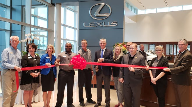 Community members celebrate the 2018 grand opening of the Jim Hudson Lexus dealership at 3410 Washington Road. A rezoning request for another Washington Road Jim Hudson dealership is raising concerns with nearby homeowners.
