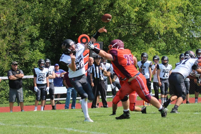 Mason Peterson pressures the Letchworth/Warsaw/Perry quarterback in Saturday's 22-14 win for Penn Yan - Dundee football. Peterson had six tackles in the contest.