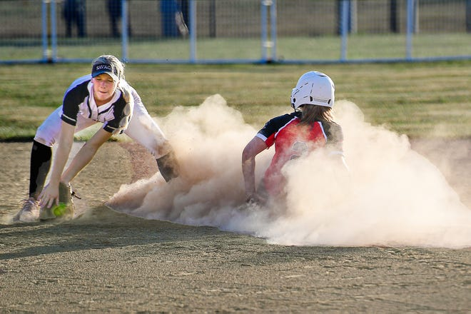 Simultaneously demonstrating the area's need for rain, Chillicothe (Mo.) HS softball Lady Hornets senior star Sophia Luetticke creates a billow of dust as she slides safely into second base with a steal in the fifth inning of Thursday's home game against Savannah. The theft made it possible for Luetticke to score a short time later on Kinlei Boley's 2-outs single, pushing CHS in front 2-0. The Lady Hornets took command of the 2021 Midland Empire Conference race with their 3-0 triumph.