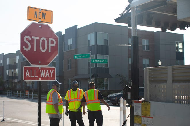 Columbus city crews install crosswalk markings, striped parking lanes with curb extensions, and a 4-way stop Thursday at the intersection of Mount Vernon and North Champion avenues in the King-Lincoln-Bronzeville neighborhood on the Near East Side as part of a larger safety plan to slow down traffic and prevent crashes along the Mt. Vernon corridor.