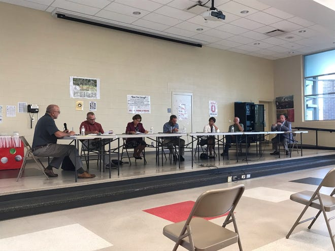 Members of the Orrville City Schools Board of Education and Superintendent James Ritchie discuss details of a temporary mask mandate in schools. A 30-day mask order was approved by a vote of 4-1.