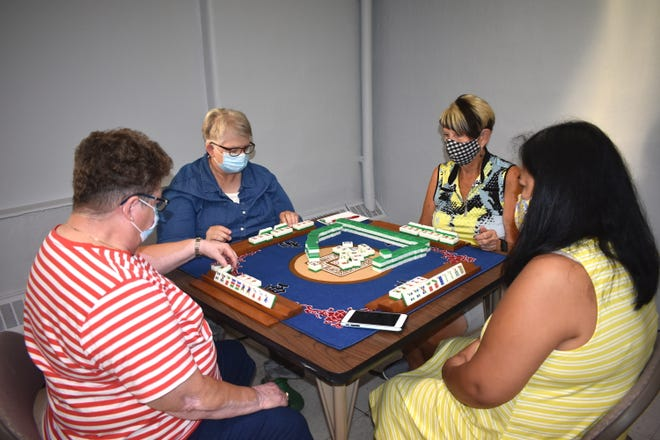Connie Geha, Sandi Williams, Agnes Linder and Loretta Seiler participate in a game of Chinese Mahjong Friday morning at the Adrian Senior Center, 327 Erie St. Games can be played once again inside the Adrian Senior Center, which is nearly fully functioning after a long COVID-19 pandemic closure. Senior centers in Addison, Blissfield, Hudson, Morenci and Tecumseh are also back open to the public.