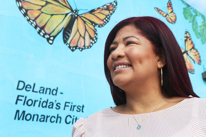 Lisse Dickson, who moved to Florida from Puerto Rico after the devastating Hurricane Maria in 2017, has settled in DeLand, where she prefers the pace, affordability and security over Orlando. Dickson was photographed in front of the butterfly mural in downtown DeLand.