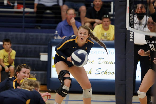 Notre Dame High School's Megan Harrell (4) watches as her blocked shot goes to the ground during their game against New London High School Thursday Sept. 16, 2021, at Notre Dame's Father Minett Gymnasium.