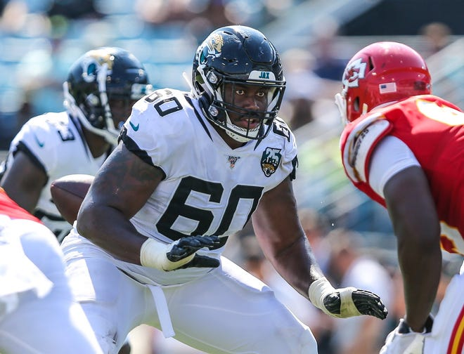 Jaguars guard A.J. Cann blocks a Chiefs defender during the Jaguars' home opener in 2019. The veteran lineman is aiming for improvement in Sunday's home opener after a rocky start against Houston.