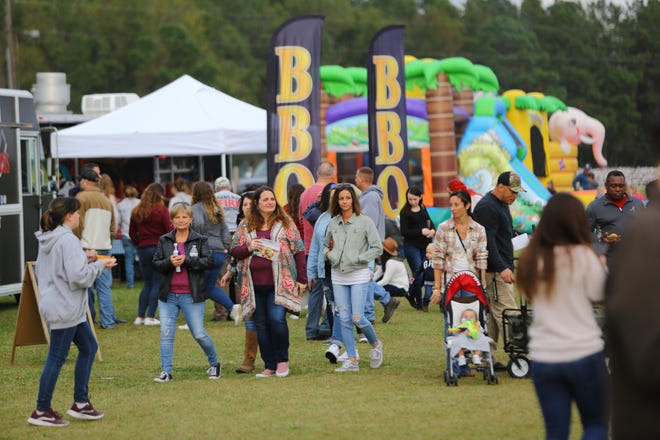 Attendees at a past Chili Cook-Off and Craft Beer Festival at Humphrey Farm in Hubert stroll through the festival grounds.