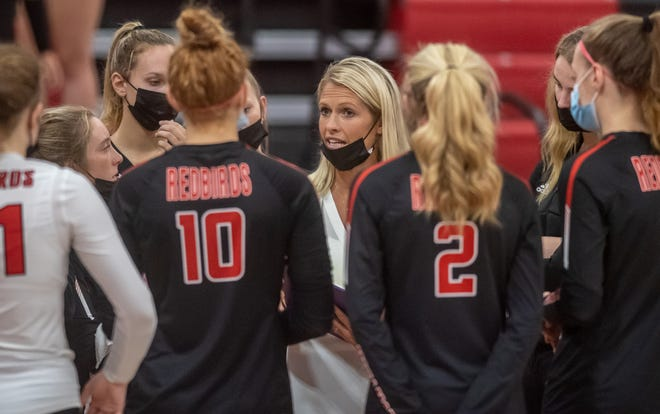 Metamora head coach Tara Ballard talks with her players before a match against Morton on Thursday, Sept. 16, 2021 at the Potterdome. Morton fell to the Redbirds in straight sets 25-16, 27-25.