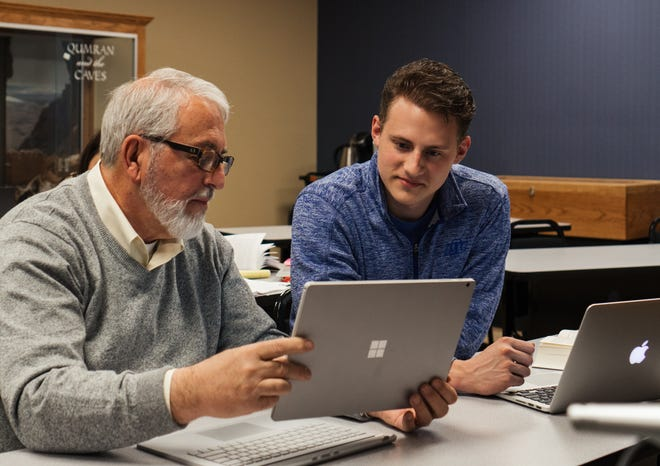 Bill Kopf, director of Technology for Lubbock Christian University, visits with student Conner Wheeler.