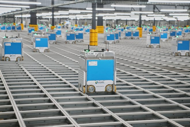 There are 500 bots cruising through Groveland's hive filling 140,000 totes with groceries bound for trucks.