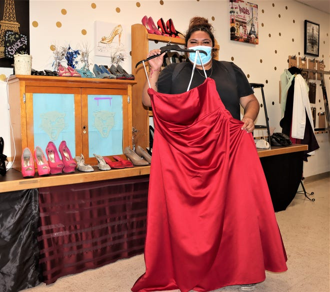 Pueblo Central High School senior Alexis Pino with a red dress from her school's CATique
