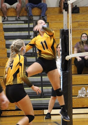 Keyser Summer Reid prepares to strike the ball against Fort Hill on Thursday. Reid was one of several players who showed up big in Keyser's win over the Sentinels.