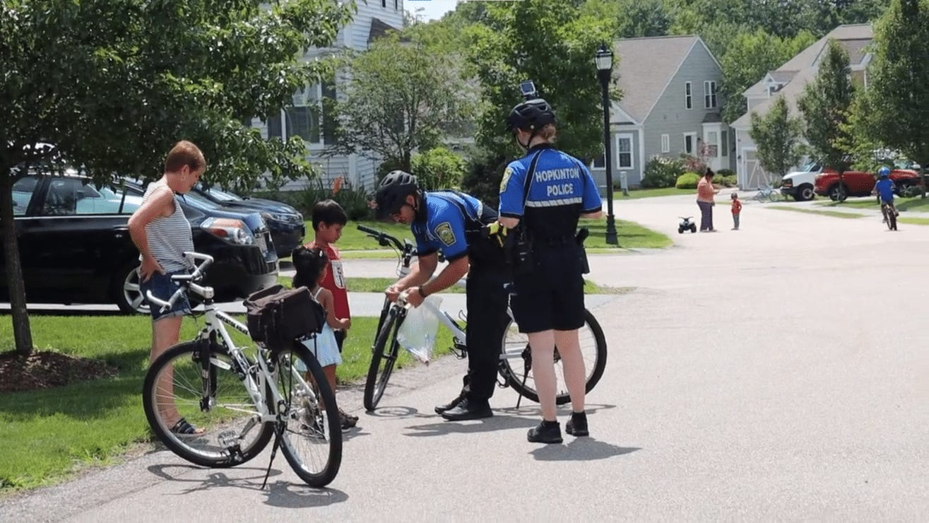 Hopkinton police officers on bike patrol making community connections
