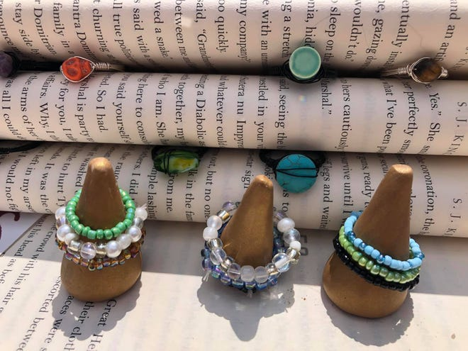 Rings designed by Clay Sol Goods on display at the River Street Market in Petersburg, Va. in Aug. of 2021.