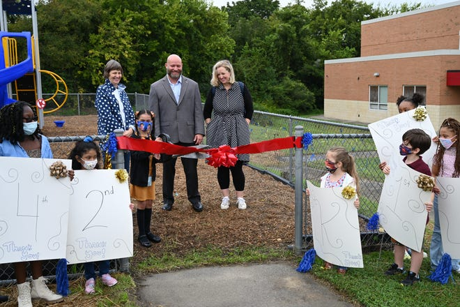 A ribbon cutting ceremony to celebrate the new Pleasants Lane playground