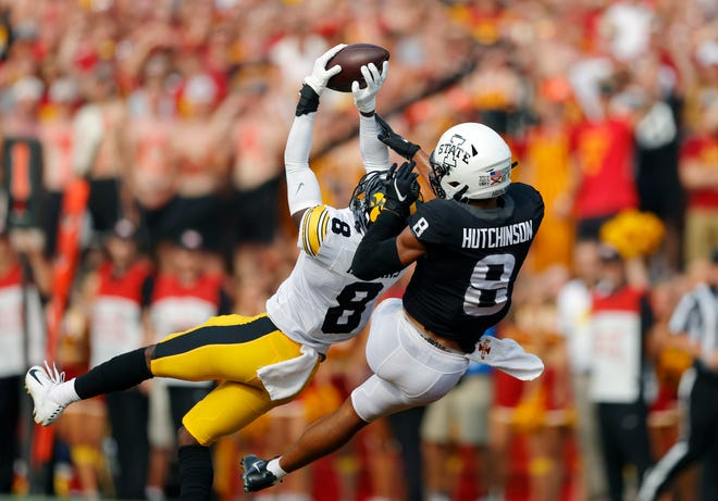 Iowa defensive back Matt Hankins makes an interception in front of Iowa State wide receiver Xavier Hutchinson during last week's game. The Cyclones had four turnovers, contributing to their 27-17 loss to the Hawkeyes.