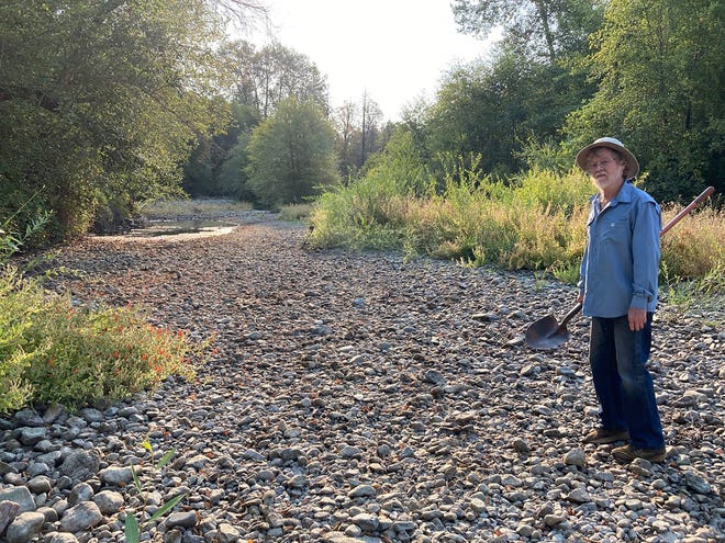 Jack Dwyer stands on the dry creek bed of Deer Creek in Selma, Ore., on Thursday, Sept. 2, 2021.