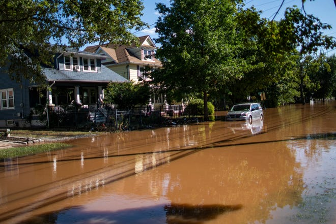 A local street remains flooded in Somerville, N.J. Thursday, Sept. 2, 2021, after Hurricane Ida walloped the region with record-breaking rain, drowning more than two dozen people in their homes and cars.